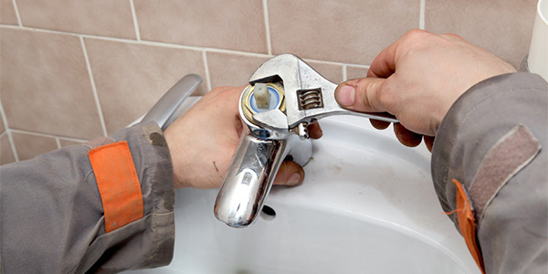Plumber working on a faucet